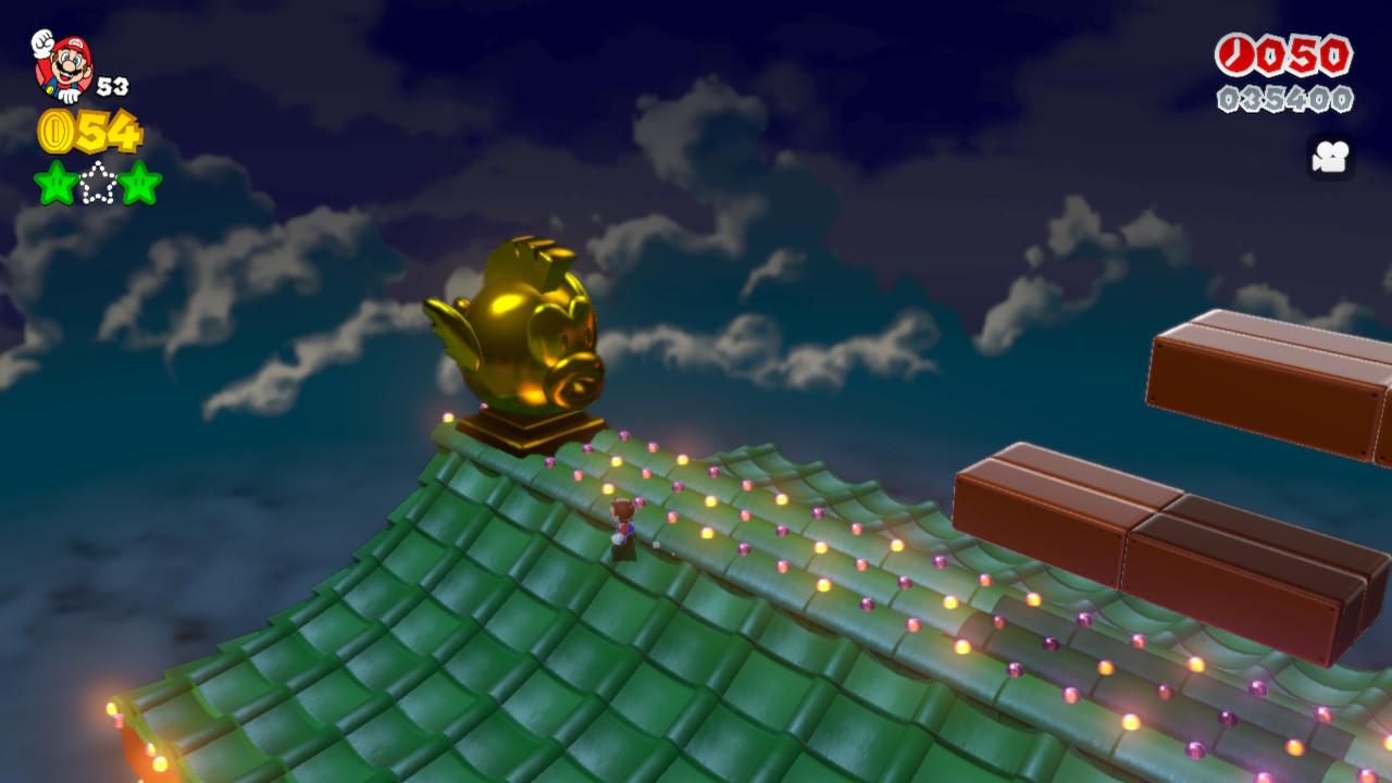 Ein alter Bekannter aus der Mario Welt ersetzt eine goldene Delphinfigur auf einem traditionellen Haus.